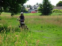 Mowing the paths during the summer months.
